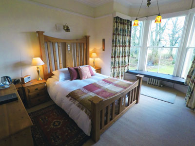 Rennie MAckintosh Style Bedroom with views over the Southern Uplands