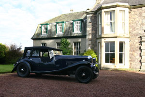 Lagonda on the front drive - ample parking space is available.