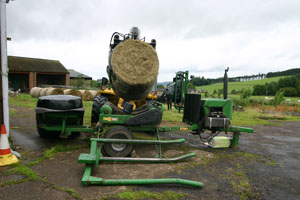 Wrapping large hay bale in the farm yard
